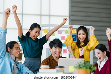 Group of Asia young creative people in smart casual wear discussing business celebrate giving five after dealing feeling happy and signing contract or agreement in office. Coworker teamwork concept.