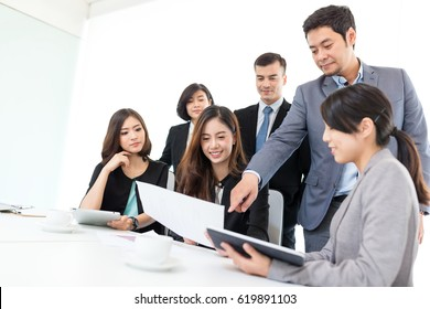 Group of asian Business people discuss in conference room
