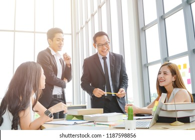 Group of Asian business people having a casual discussion.