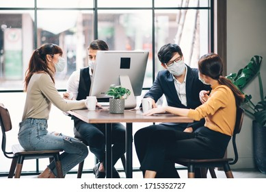 Group of Asian Business People Successful Teamwork in Casual Suit Working Together with Laptop Computer at Co-Working Space