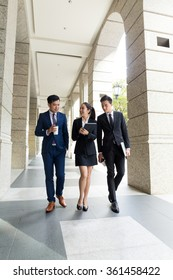 Group of asian business people walking on the street
