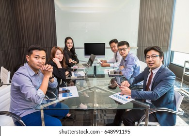 Group of asian Business team having video conference with monitor display in the modern conference room, Business people meeting concept