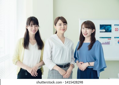 Group of asian businesswoman standing in office.