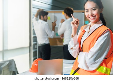 Group of asian and caucasian young creative happy enjoy laugh smile and great success emotion teamwork people engineer consultant entrepreneur casual brainstorm business meeting office background