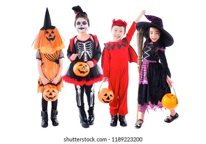 Group of asian children wearing halloween costume standing over white background