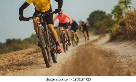 Group of Asian cyclists, they cycle through rural and forest roads.