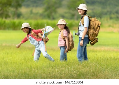 Group asian family children walking in the jungle adventure and tourism for destination and leisure trips for education and relax in nature park.  Travel vacations and Life Concept