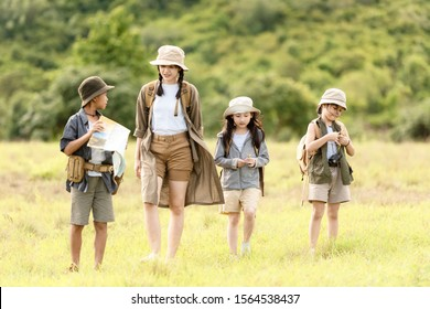 Group asian family children walking in the jungle adventure and tourism for destination and leisure trips for education explore and relax in nature park.  Travel vacations and Life Concept