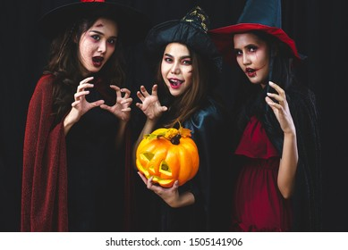 Group of Asian girls with a ghost pumpkin in their hands wear a fantastic Halloween costume. The celebration was very interesting.
