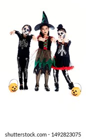 Group of asian Kids 5-8 years with face paint in wearing halloween costume on white background