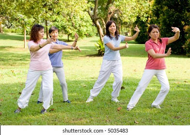 A group of asian ladies exercising in the park