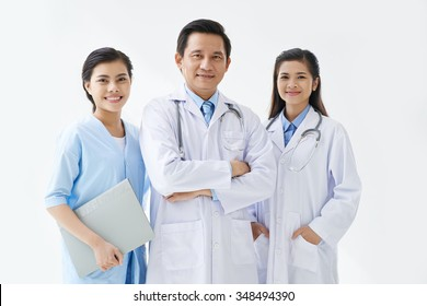 Group of Asian medical workers smiling at camera