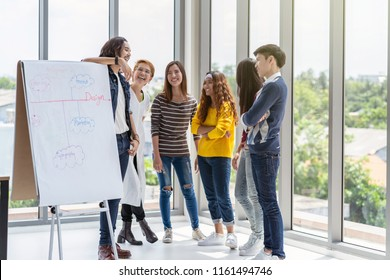 Group Of Asian and Multiethnic Business people with casual suit talking and brainstorming with happy action in creative style in the modern workplace, modern creative and design worker concept