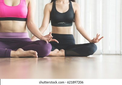 Group Asian People practicing yoga. Close up hands in meditating gesture. Copy space.