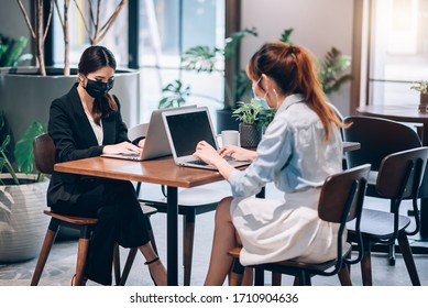 Group of Asian People Successful Teamwork Businesswoman Wearing Medical Mask and Working with Laptop. Work from Private Home Office Social Distancing among Coronavirus Outbreak Situation
