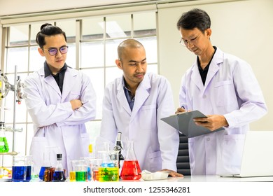 Group of asian scientists Studying and testing evaluation of experimental results in the laboratory.This is a biology research.