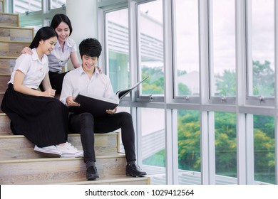 Group of Asian student in Thai university sit and relax in library, this immage can use for education, school and back to school concept