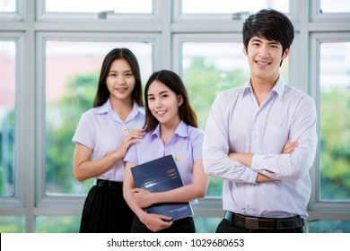 Group of Asian student in Thai university stand in library, this immage can use for education, school and back to school concept
