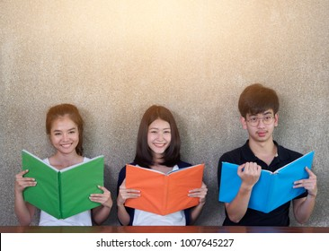 Group of asian students doing homework together in the university library.group of asian students reading books in the university library