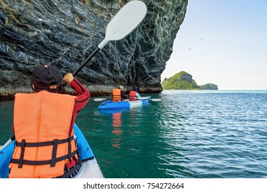 Group Asian tourist on a kayak, Happy family adventure by boat enjoy the beautiful nature of the sea and island in summer, Travel Asia at Mu Ko Ang Thong National Marine Park, Surat Thani, Thailand