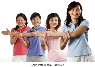 A group of Asian woman exercising in the studio on white background