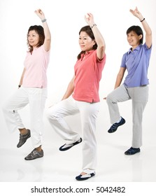 A group of Asian women exercising in the studio