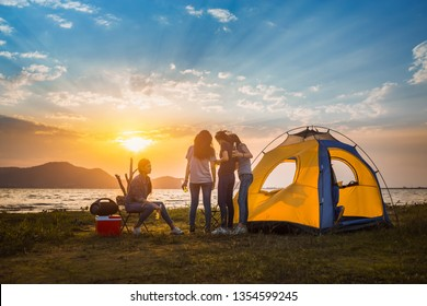 Group of asian women party with drink bottles enjoy travel camping,trekking in vacation time at sunset.