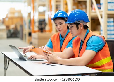 Group of Asian young male and female employee worker working computer notebook and discussing in the automotive spare parts industry factory warehouse. Inspection quality control