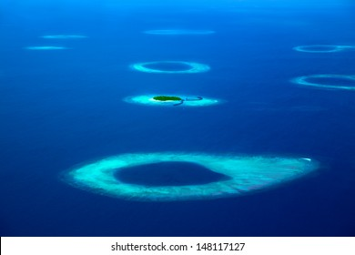Group of atolls in Maldives from aerial view