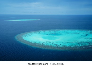 Group of atolls in Maldives from seaplane