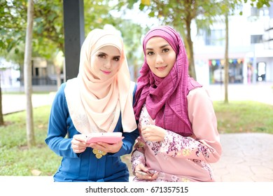 group of attractive Asian woman with hijab together. best friend hugs each other