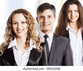 A group of attractive and successful business, ready for serious