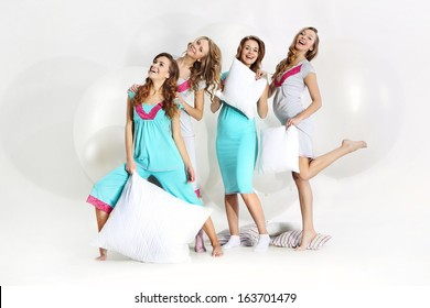 Group of attractive young pregnant women