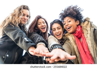 Group of attractive young women of different ethnics - Four students smiling at camera - Best friends spending time together