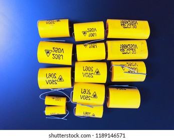 Group of audiophile metal-film axial capacitors different sizes.