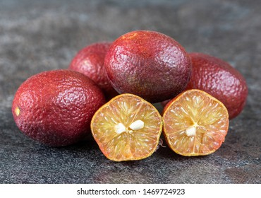 group of australia natural red fingerlime on dark blackground in selective focus
