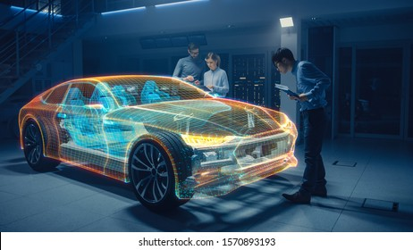 Group of Automobile Design Engineers Working in Virtual Reality 3D Model Prototype of Electric Car Chassis. Automotive Innovation Facility: 3D Concept Vehicle Generated with 3D CAD Software.