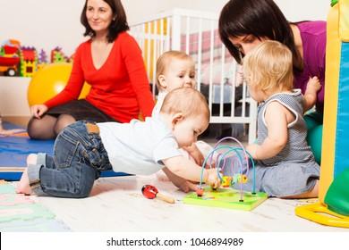 Group babies in playroom
