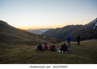 Group of backpackers watching the sunset in the mountains in New Zealand