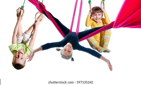 group of barefeet children shouting screaming jumping dancing exercising, Isolated over white background. Childhood, freedom, happiness, active lifestyle concept. Young jumpers kids girls boys