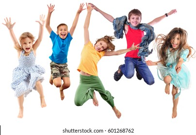 group of barefeet children shouting screaming jumping dancing. Isolated over white background. Childhood, freedom, happiness, active lifestyle concept. Young jumpers kids girls an boy