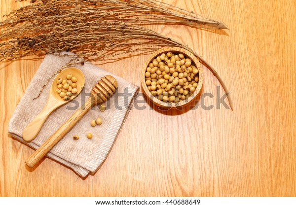 group of bean on spoon on wooden with dry tree and handkerchief
