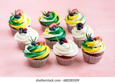 Group of beautiful cupcakes Tasty colorful cupcakes decorated with fresh berries Above