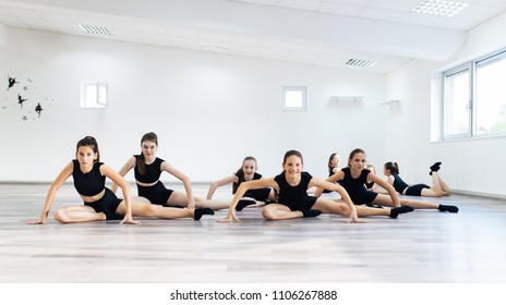 The group of beautiful girls practicing modern ballet dance.