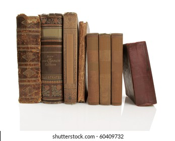 Group of beautiful old books on a white reflective background