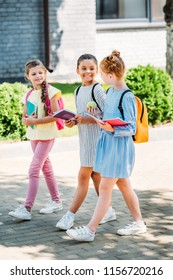group of beautiful schoolgirls walking together after school