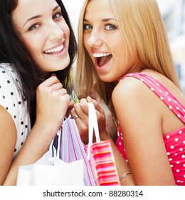 Group of beautiful shopping women with bags and smiling