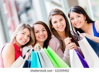 Group of beautiful shopping women holding bags