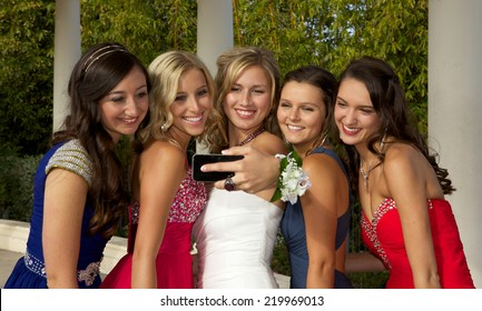 Group of  Beautiful Teenage Girls Going to the Prom taking a Selfie