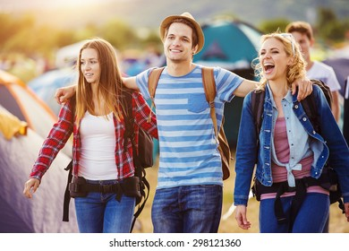Group of beautiful teens arriving at summer festival. Young teens at summer music festival. Funny group of young girls and boys at music festival. Happy teen at summer festival.